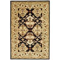 Safavieh Handmade Heritage Timeless Traditional Black/ Ivory Wool Rug - 5' x 8'
