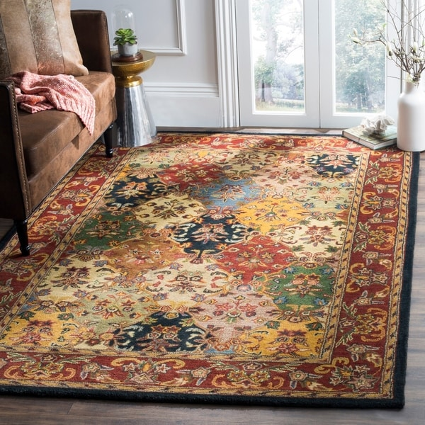 Safavieh Handmade Heritage Timeless Traditional Multicolor/ Burgundy Wool Rug - 7'6 x 9'6