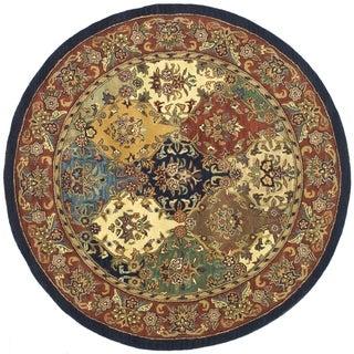 Safavieh Handmade Heritage Timeless Traditional Multicolor/ Burgundy Wool Rug (3'6 Round)