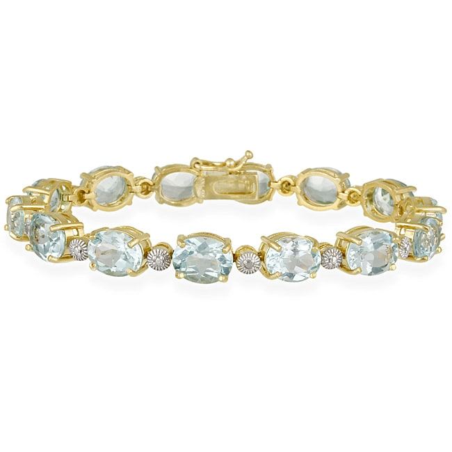 Glitzy Rocks 18k Gold over Sterling Silver 30.1 CTW Blue Topaz and Diamond Accent Bracelet