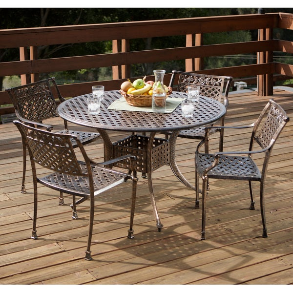 Sebastian Cast Aluminum Copper Outdoor Dining Set by Christopher Knight Home - Shop Sebastian Cast Aluminum Copper Outdoor Dining Set By