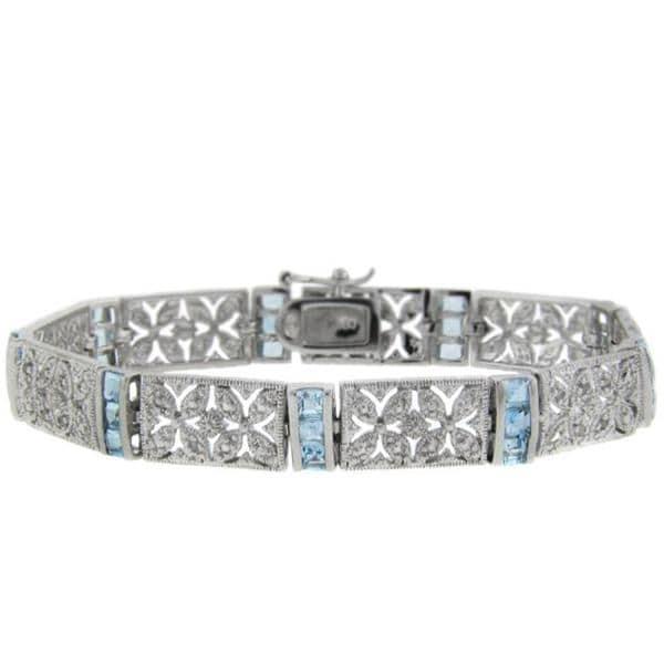 Dolce Giavonna Sterling Silver Blue Topaz and Diamond Accent Filigree Flower Bracelet