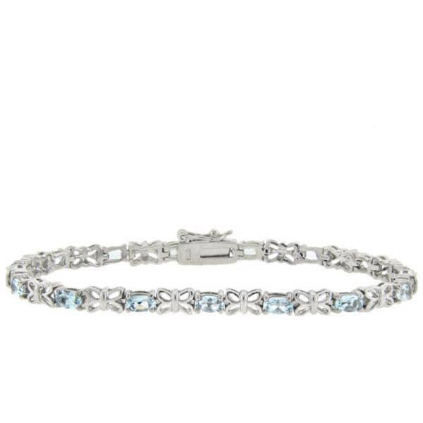 Dolce Giavonna Sterling Silver Blue Topaz and Diamond Accent Bracelet