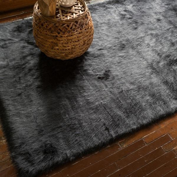 Shop Faux Sheepskin Black Shag Area Rug