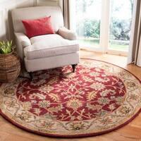 Safavieh Handmade Heritage Traditional Kashan Red/ Ivory Wool Rug - 6' x 6' Round
