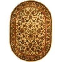 """Safavieh Handmade Heritage Ivory Wool Rug - 7'6"""" x 9'6"""" oval"""