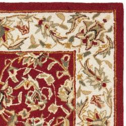 Safavieh Hand-hooked Chelsea Tabriz Burgundy/ Ivory Wool Rug (2' 9 x 4' 9) - Thumbnail 1