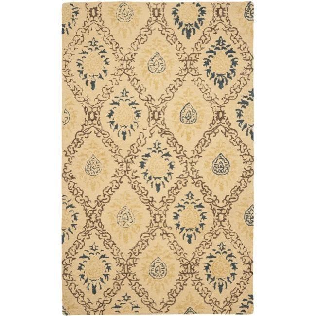 Safavieh Handmade Traditions Beige Wool Rug - 7'6 x 9'6