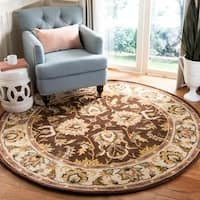 Safavieh Handmade Heritage Timeless Traditional Brown/ Ivory Wool Rug - 6' x 6' Round