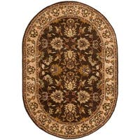 "Safavieh Handmade Heritage Timeless Traditional Brown/ Ivory Wool Rug - 7'6"" x 9'6"" oval"