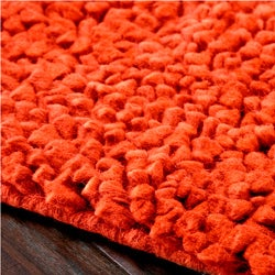 Hand-woven Nimbus Rust Wool Rug (5'x8') - Thumbnail 1