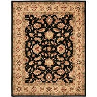 Safavieh Handmade Heritage Timeless Traditional Black/ Gold Wool Rug - 9'6 x 13'6