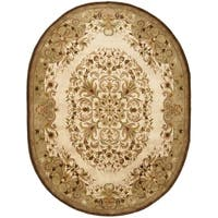"Safavieh Handmade Heritage Timeless Traditional Beige Wool Rug - 7'6"" x 9'6"" oval"