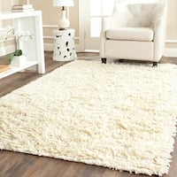 Safavieh Handmade Shaggy Ivory Natural Wool Area Rug - 5' x 8'