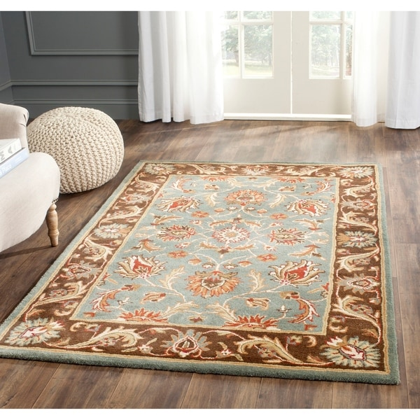 Safavieh Handmade Heritage Timeless Traditional Blue/ Brown Wool Area Rug - 7'6' x 9'6'