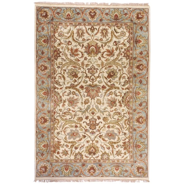 Hand-knotted Finial Cream Wool Area Rug - 5'6 x 8'6