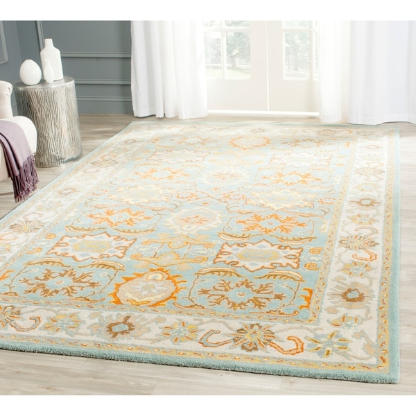 Safavieh Handmade Heritage Timeless Traditional Light Blue/ Ivory Wool Rug - 6' x 9'