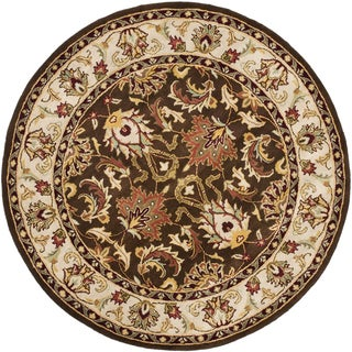 Safavieh Handmade Heritage Timeless Traditional Brown/ Ivory Wool Rug (6' Round)
