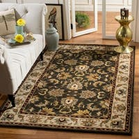 Safavieh Handmade Heritage Timeless Traditional Black/ Ivory Wool Rug - 4' x 6'