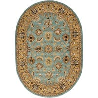 Safavieh Handmade Heritage Timeless Traditional Blue/ Gold Wool Rug (4'6 x 6'6 Oval) - 4'6' x 6'6 oval