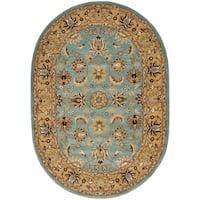 "Safavieh Handmade Heritage Timeless Traditional Blue/ Gold Wool Rug - 4'6"" x 6'6"" Oval"