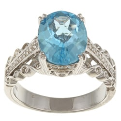 Sterling Silver Blue Topaz and 1/3ct TDW Diamond Ring (J, I2-I3)