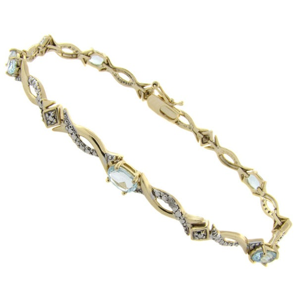 Dolce Giavonna 18k Gold over Silver Blue Topaz and Diamond Accent Bracelet. Opens flyout.