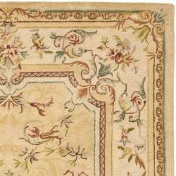 Safavieh Handmade Light Gold/ Beige Hand-spun Wool Rug (9' x 12') - Thumbnail 1