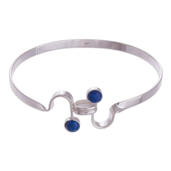 Handmade Sterling Silver 'Opposites Attract' Lapis Lazuli Bracelet (Peru). Opens flyout.