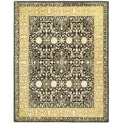 Safavieh Handmade Silk Road Black/ Ivory New Zealand Wool Rug (7'6 x 9'6) - Thumbnail 1