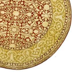 Safavieh Handmade Silk Road Maroon/ Ivory New Zealand Wool Rug (3'6 Round) - Thumbnail 1