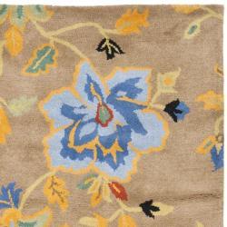 Safavieh Handmade Soho Paradise Brown New Zealand Wool Rug (7'6 x 9'6) - Thumbnail 1