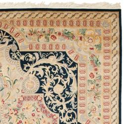 Asian Hand-knotted Royal Kerman Black/ Ivory Wool Rug (8' x 10') - Thumbnail 1