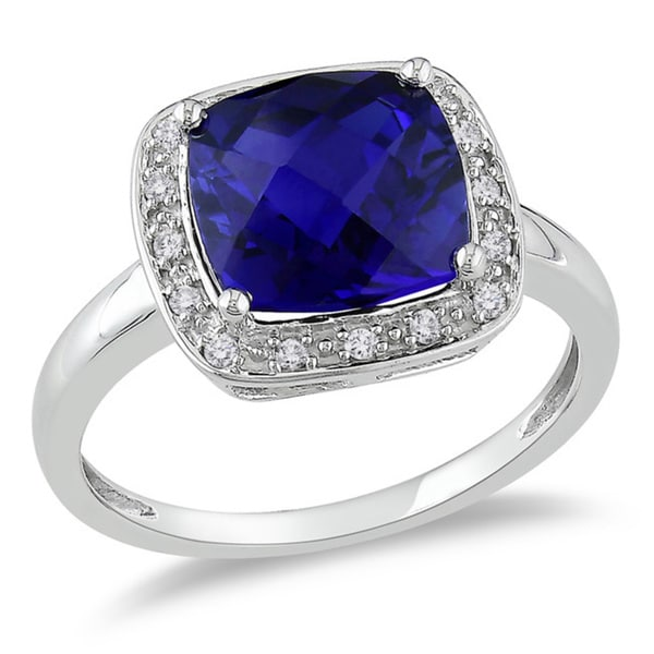 Miadora 10k White Gold Created Blue Sapphire and 1/10ct TDW Diamond Halo Cocktail Ring (G-H, I2-I3)