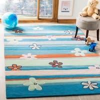 Safavieh Handmade Children's Spring Sky Blue N. Z. Wool Rug - 8' x 10'