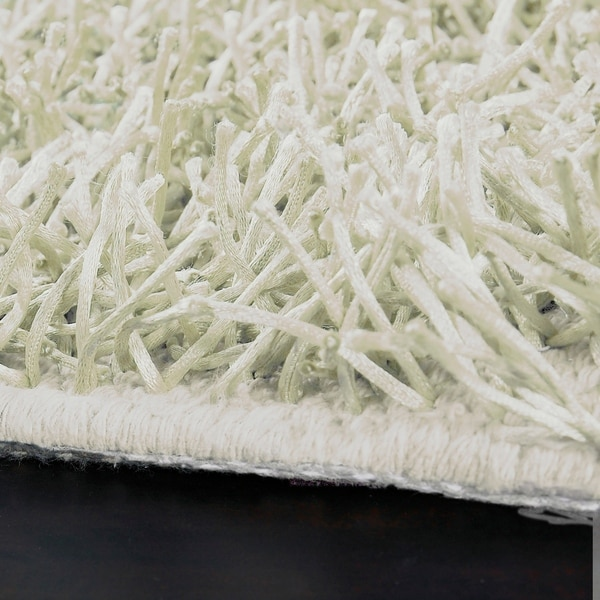Hand-woven Hawn White Soft Shag Area Rug - 10' Round. Opens flyout.