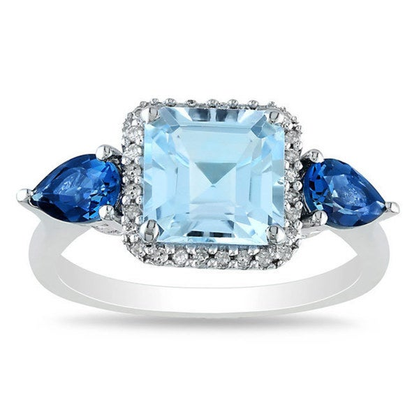 Miadora Sterling Silver Blue Topaz and 1/6ct TDW Diamond Ring (G-H, I2-I3)