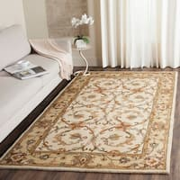 Safavieh Handmade Heritage Timeless Traditional Beige/ Gold Wool Rug - 6' x 9'