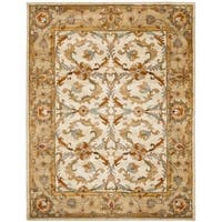 Safavieh Handmade Heritage Timeless Traditional Beige/ Gold Wool Rug - 7'6 x 9'6