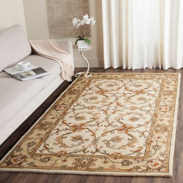 Safavieh Handmade Heritage Timeless Traditional Beige/ Gold Wool Rug - 7'6 x 9'6