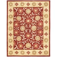Safavieh Handmade Heritage Timeless Traditional Red/ Beige Wool Rug - 6' x 9'