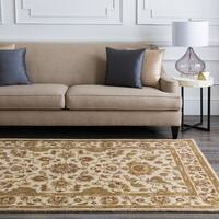 Hand-tufted Pennine Ivory Floral Border Wool Area Rug - 2'6 x 8'