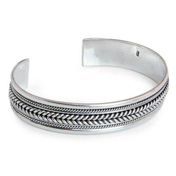 Lanna Illusions Braid Patterns Coil Around the Wrist in this 925 Sterling Silver Contemporary Womens Cuff Bracelet (Thailand). Opens flyout.