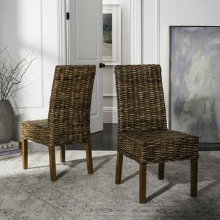 "Link to SAFAVIEH Dining Rural Woven St. Thomas Wicker Brown Dining Chairs (Set of 2) - 21.7"" x 19.3"" x 38.6"" Similar Items in Kitchen & Dining Room Chairs"