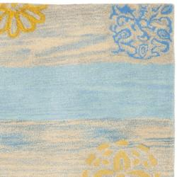 Safavieh Handmade Eternity Blue New Zealand Wool Rug (2'6 x 8') - Thumbnail 1