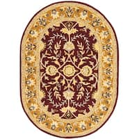 """Safavieh Handmade Heritage Timeless Traditional Red/ Gold Wool Rug - 4'6"""" x 6'6"""" Oval"""