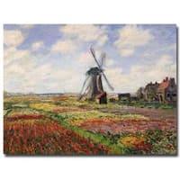 Claude Monet 'Tulip Fields with Rijnsburg Windmill 1886' Canvas Art - Multi