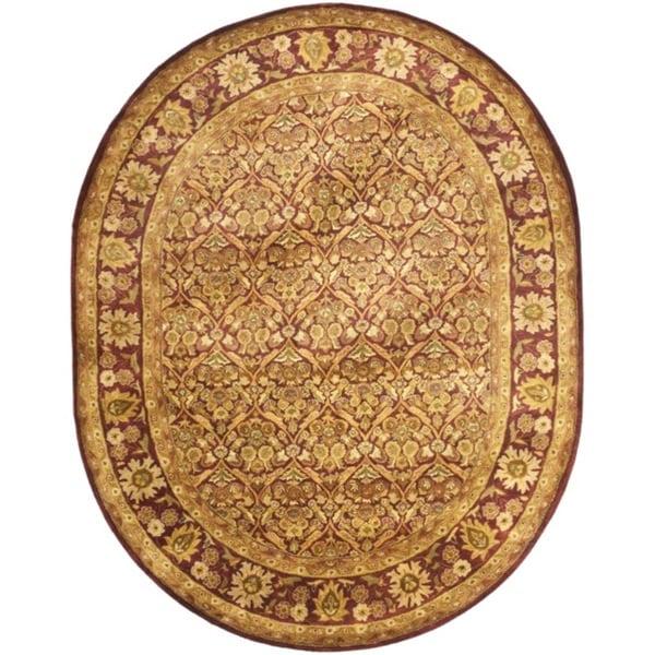 "Safavieh Handmade Heritage Wine Red Wool Rug - 7'6"" x 9'6"" oval"