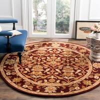 Safavieh Handmade Heritage Wine Red Wool Rug - 6' x 6' Round