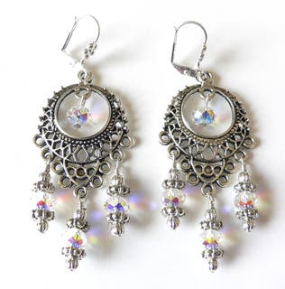 Silvertone Crystal 'Annabella' Chandelier Earrings https://ak1.ostkcdn.com/images/products/6509353/6509353/Silvertone-Crystal-Annabella-Chandelier-Earrings-P14097441.jpg?impolicy=medium